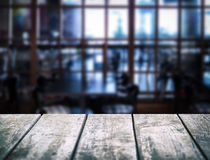 Empty wooden table. Blurred interior of cafe. Empty space for your products and information Stock Photography