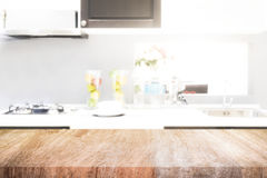 Empty wooden table and blurred kitchen background for display or. Montage your products Royalty Free Stock Photos