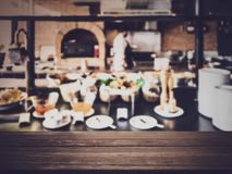 Empty wooden table with blurred kitchen background stock images