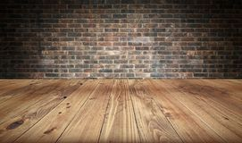 Empty wooden table and brick wall in background. 3d rendering Royalty Free Stock Images