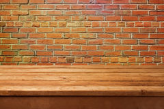 Empty wooden table and brick wall. Ready for product montage display. Royalty Free Stock Photos