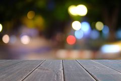 Black wooden table on front blurred coffee shop background