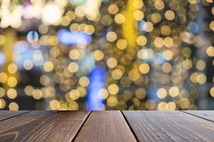 Empty wooden table of brown on front blurred colorful background, for presentation and advertising product and template. Website banner stock image