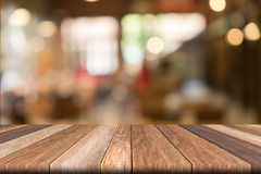 Empty wooden table of brown in front Warm orange color of bokeh on wooden. Background royalty free stock photo