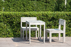 Empty wooden table and chairs of a tropical garden Royalty Free Stock Image