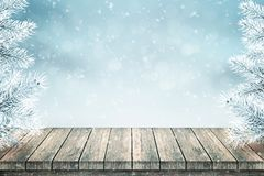 Empty wooden table and Christmas fir trees covered with snow royalty free stock images