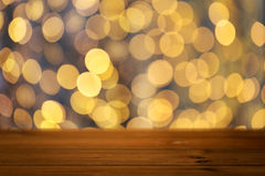 Empty wooden table with christmas golden lights Stock Photos