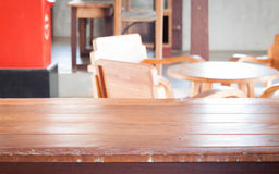 Empty wooden table in coffee shop Stock Photo