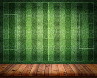 Empty wooden table or counter with football field wall background. stock photos