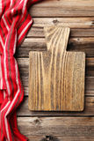 Empty wooden table with cutting board Stock Photos