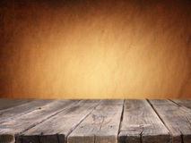 Empty wooden table and dark wall Royalty Free Stock Photo
