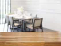 Empty wooden table and dining room Royalty Free Stock Images