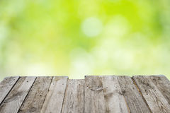 Empty wooden table with foliage bokeh Stock Photo