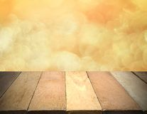 Empty wooden table in front of bokeh lights background. Free space for text Stock Photography