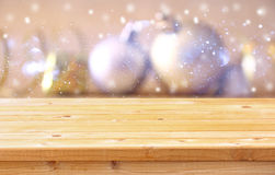 Empty wooden table in front of christmas tree decorations Stock Image