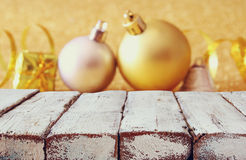 Empty wooden table in front of christmas tree decorations Royalty Free Stock Photography