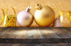 Empty wooden table in front of christmas tree decorations Stock Photos