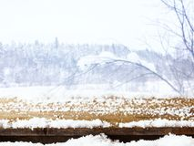 Empty wooden table in front of dreamy and magical winter landscape background. For product display montage. Empty wooden table in front of dreamy and magical Stock Photos