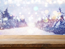Empty wooden table in front of dreamy winter landscape Royalty Free Stock Photography