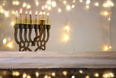 Empty wooden table in front of jewish holiday Hanukkah background with menorah & x28;traditional candelabra& x29; Stock Image