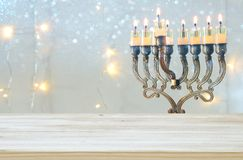 Empty wooden table in front of jewish holiday Hanukkah background with menorah & x28;traditional candelabra& x29; Royalty Free Stock Images
