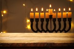 Empty wooden table in front of jewish holiday Hanukkah background with menorah & x28;traditional candelabra& x29; Stock Photos