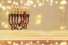 Empty wooden table in front of jewish holiday Hanukkah background with menorah & x28;traditional candelabra& x29; Royalty Free Stock Photography