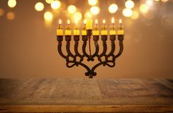 Empty wooden table in front of jewish holiday Hanukkah background with menorah & x28;traditional candelabra& x29; Royalty Free Stock Photos