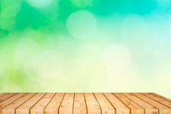 Empty wooden table with garden bokeh for a catering or food background with a country outdoor theme,Template mock up for display stock photos