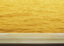 Empty wooden table with gold water surface texture, for your pro Stock Photos
