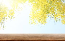 Empty wooden table with Golden shower or Cassia fistula is a background. Product display template stock photo