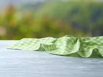 Empty wooden table with green tablecloth Royalty Free Stock Photography