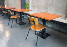 Empty wooden table in grey room Stock Photo
