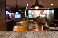 Empty Wooden Table In Front Of Blurred Background Of Tables And Bar Chairs Royalty Free Stock Photography