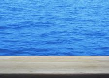 Empty wooden table with ocean water surface texture. For your product display montage Stock Photo