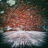 Empty wooden table with old brick wall Stock Photos