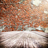 Empty wooden table with old brick wall on the background Royalty Free Stock Photography