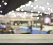 Empty wooden table over blur mall Stock Photography