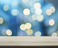Empty wooden table over blurred mall bokeh background Royalty Free Stock Image