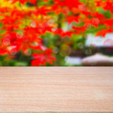 Empty wooden table. Over bokeh natural background. Ready for montage Royalty Free Stock Photography