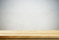 Empty wooden table over cement wall Royalty Free Stock Photos