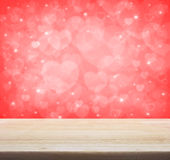 Empty wooden table over light red heart bokeh background, valent Royalty Free Stock Photos
