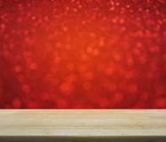 Empty wooden table over red blur light, Christmas background Royalty Free Stock Image