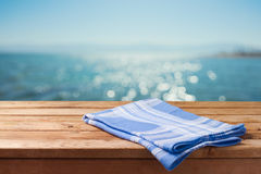 Empty wooden table over sea beach bokeh background. Summer picnic on beach background Stock Photo