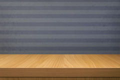 Empty wooden table over vintage blue wallpaper with stripes Stock Photography