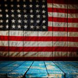 Empty wooden table over vintage USA flag background. Royalty Free Stock Photos