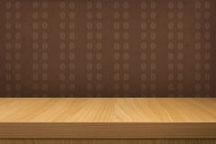Empty wooden table over vintage wallpaper with pattern coffee be Royalty Free Stock Photography
