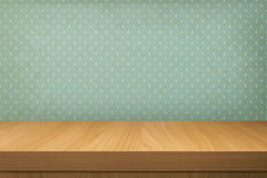 Empty wooden table over vintage wallpaper with a pattern of rain Stock Images
