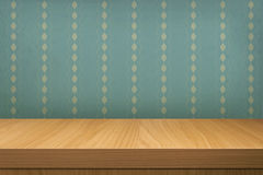 Empty wooden table over vintage wallpaper Stock Photo