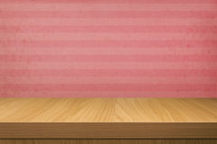 Empty wooden table over vintage wallpaper with stripes Stock Images